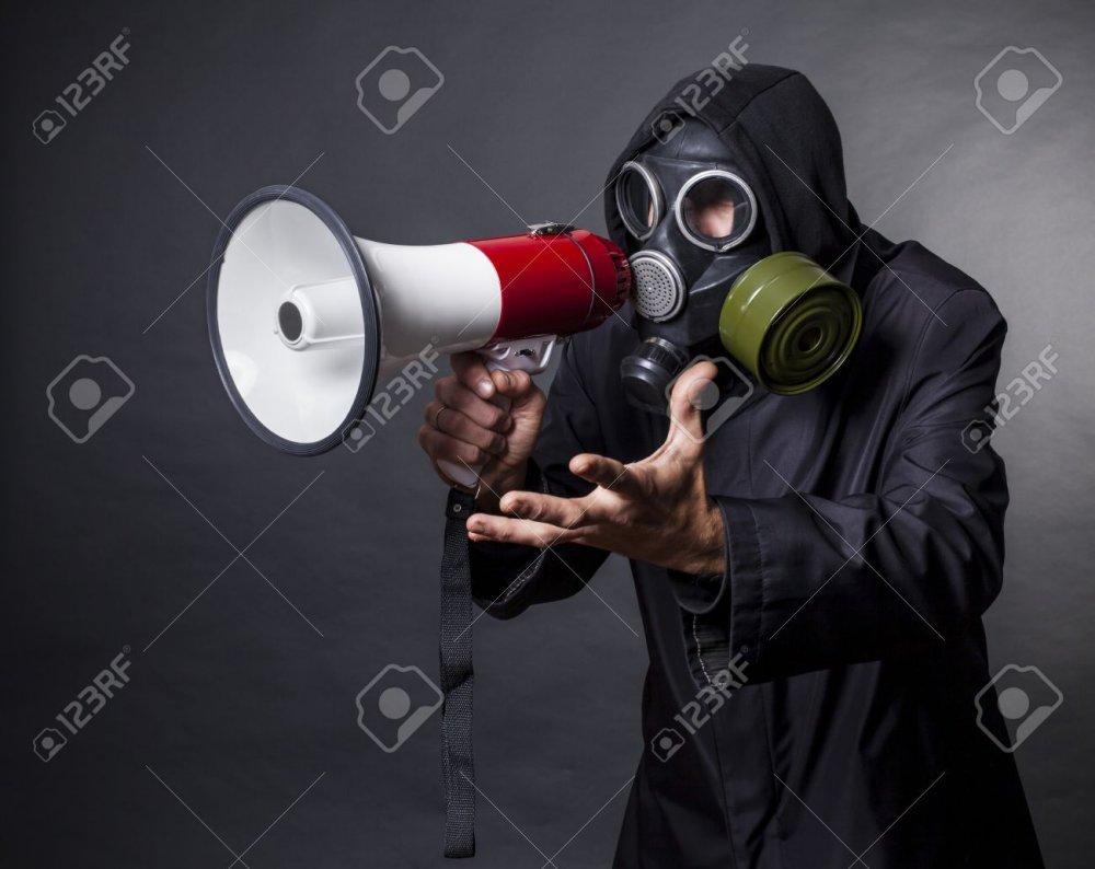 15896920-a-man-in-a-gas-mask-with-a-megaphone-calling-for-help.thumb.jpg.2054baf6b3ca772e5cab30e75431d3fa.jpg
