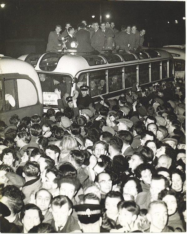 1954 League Cup, team home on top of bus.jpg