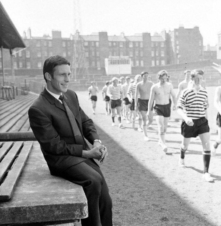 Roald Jensen watches as his team mates train at Tynecastle.jpg